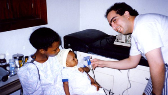 Dr. Manshadi volunteering in Honduras.